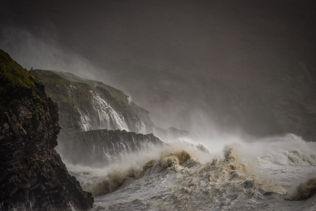 Cliffs by Stormy Waves